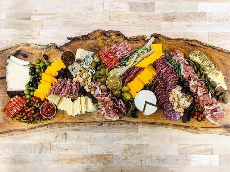 custom charcuterie board made from items found in our deli and salad cooler