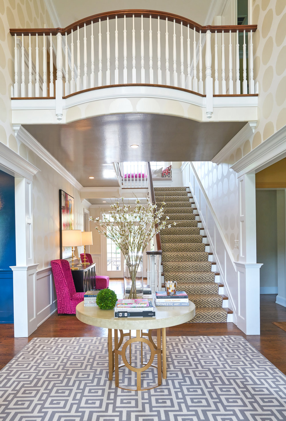 Beautiful furnishings bring glamour to entryway.