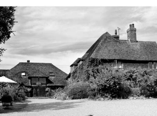 """Elvey Farm has been turned into a Boutique Hotel in 2007.   """"Perhaps the most prolific ghost at Elvey Farm is the ghost of Edward Brett, who was a farmer at the hotel at the turn of the previous century. In 1900, he gave his wife 15 shillings, each of his children a penny, then walked calmly into the dairy and shot himself. The inquest into his death returned a verdict of 'suicide whilst temporarily insane'. Mr. Brett has since been seen many times around the farm, often walking around the corridors of the hotel. """" -    Elvey Farm"""