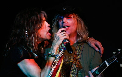 Paul singing with Steven Tyler onstage at The Hard Rock, Boston