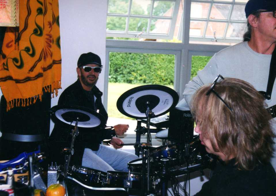 Paul jamming with Ringo Starr in England