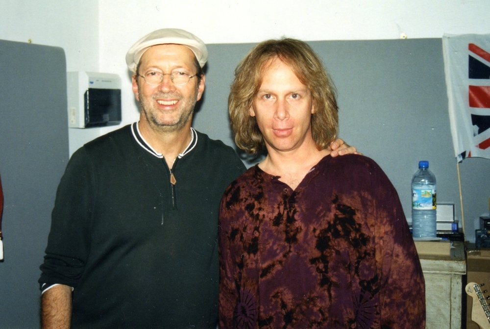 Posing with Eric Clapton after recording him