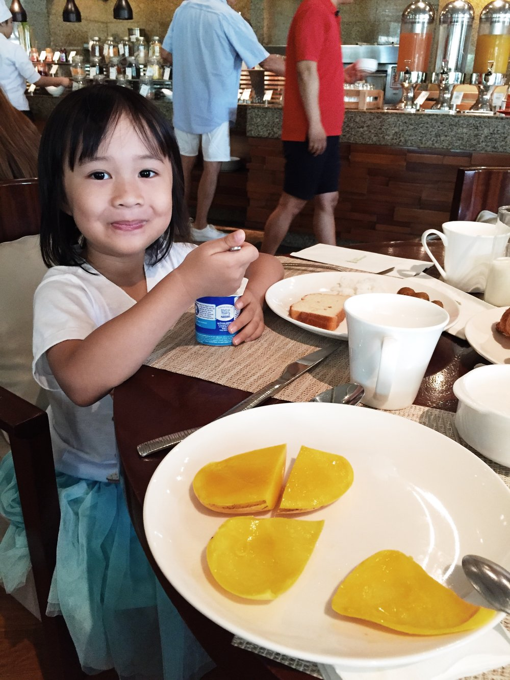Rise and shine the next morning! Rae loves scooping out the fresh super sweet mangoes and put them in her yogurt!
