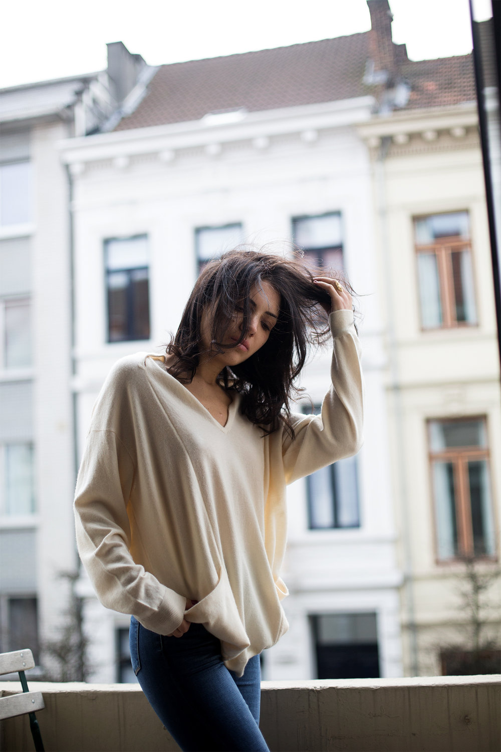 Wearing a vintage cashmere sweater from Yves Saint-Laurent (Jutka & Riska)