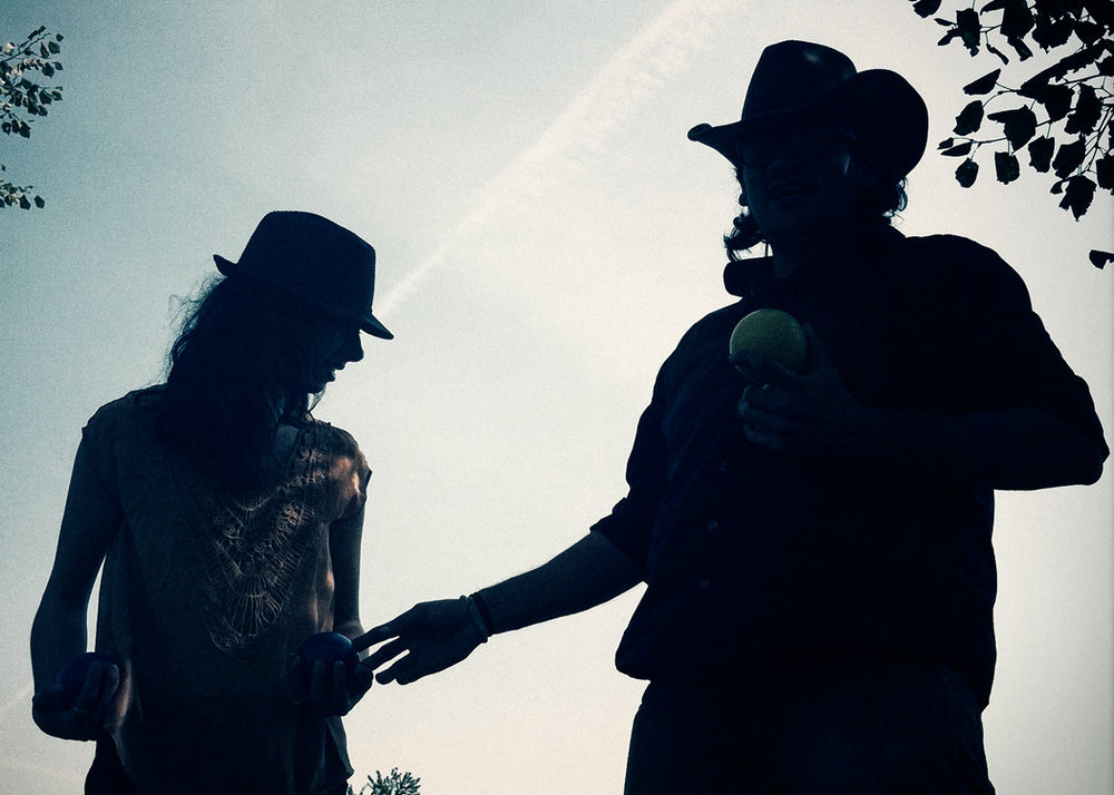 silhouetted-engagement-portrait-of-couple-playing-bocce-ball-by-arcata-wedding-and-engagement-photographer-kate-donaldson-photography.jpg