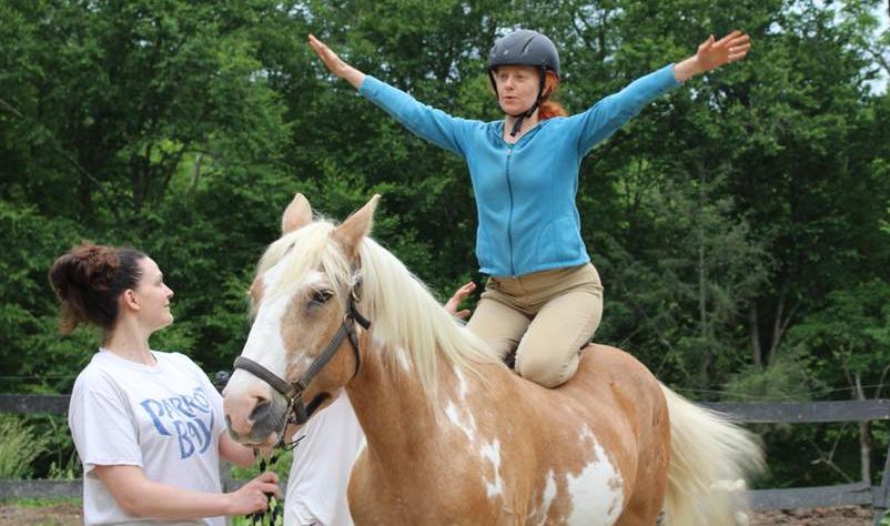 hero pose on horse.jpg