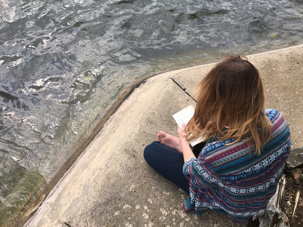 Olyvia Fulford enjoys her quiet time with God by the edge of the lake that cool morning