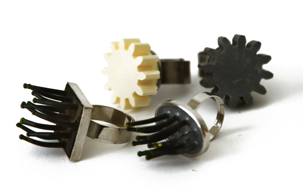 Various Rings (Cast enlarger knobs, Found comb bristles, Resin, Etc…), 2014