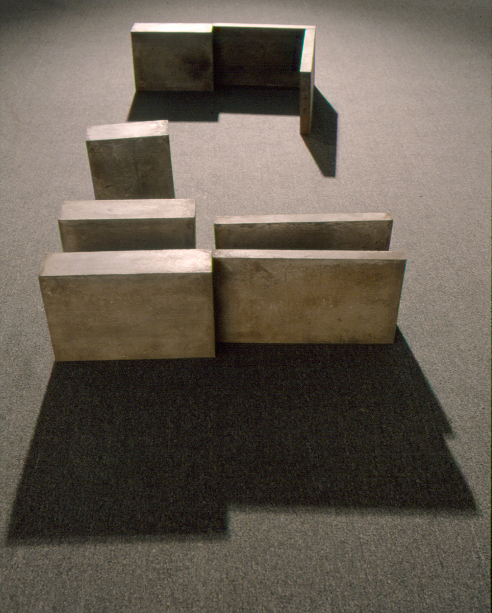 Ombres portées    (1981)   Ciment, 42.5, 133 x 333 cm, collection du Musée d'art contemporain de Montréal. photo : Ron Diamond