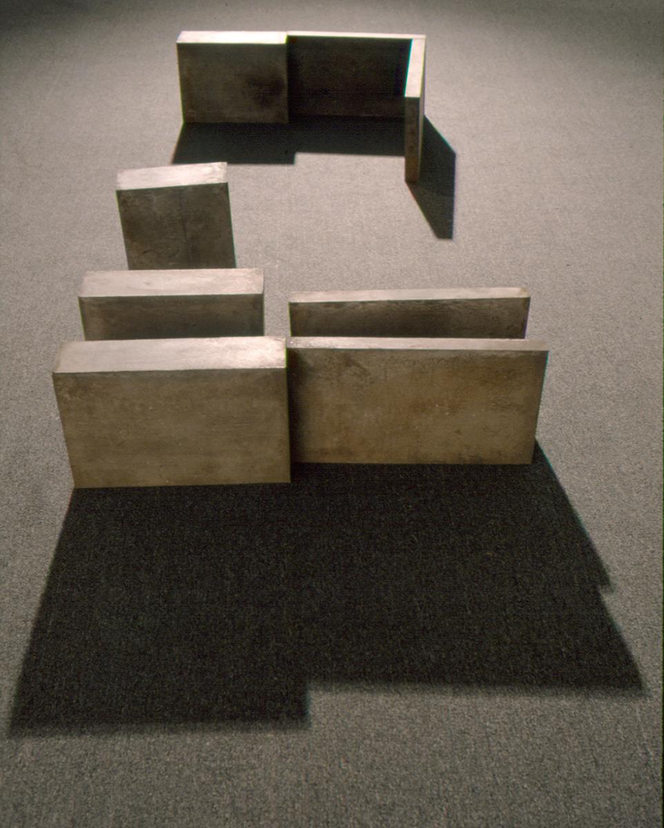 Ombres portées    (1981)   Ciment, 42.5, 133 x 333 cm, collection du Musée d'art contemporain de Montréal. photo : Ron Diamond
