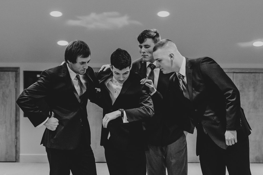 Groom and groomsmen checking the time at Applegate Christian Fellowship.
