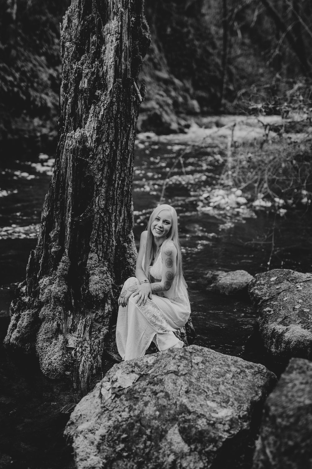 Smiling senior girl by river in Ashland Oregon