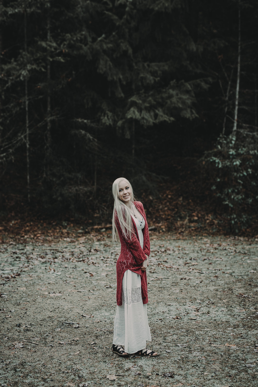 Senior girl in woods wearing white dress