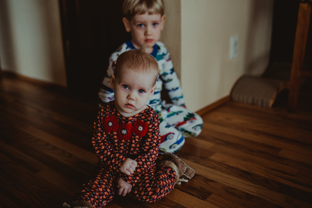 Baby girl in pajamas with brother in Southern Oregon home.