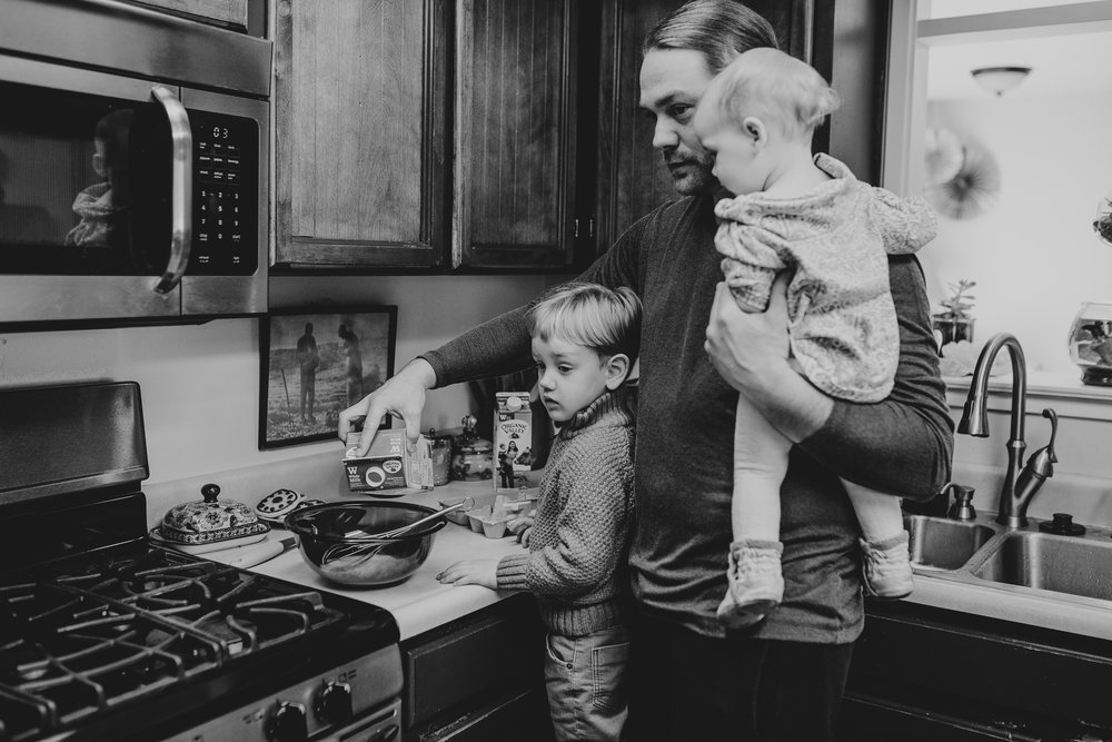 Dad and kids making breakfast