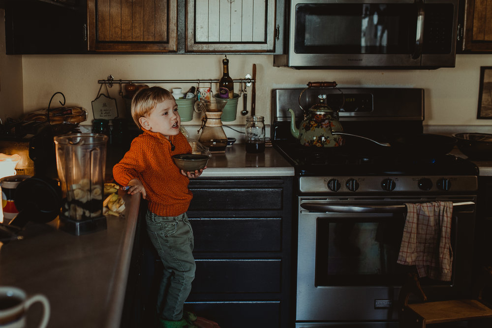 Boy holding blueberries in bowl
