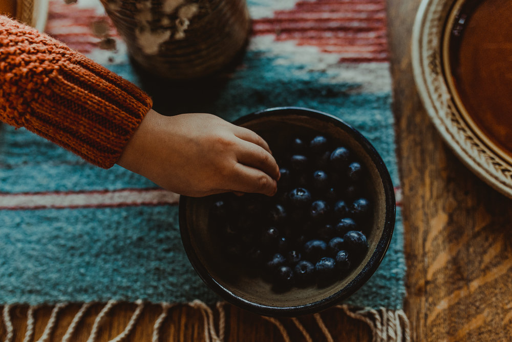 Toddler grabs blueberries in Ashland Oregon home
