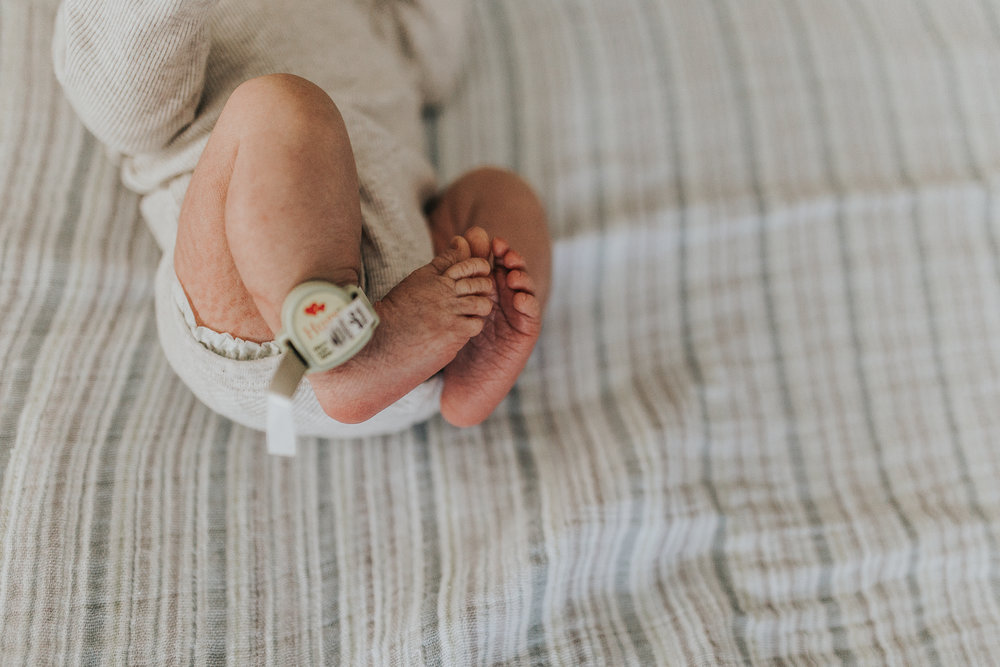Newborn baby in Medford Oregon hospital room wearing security bracelet.