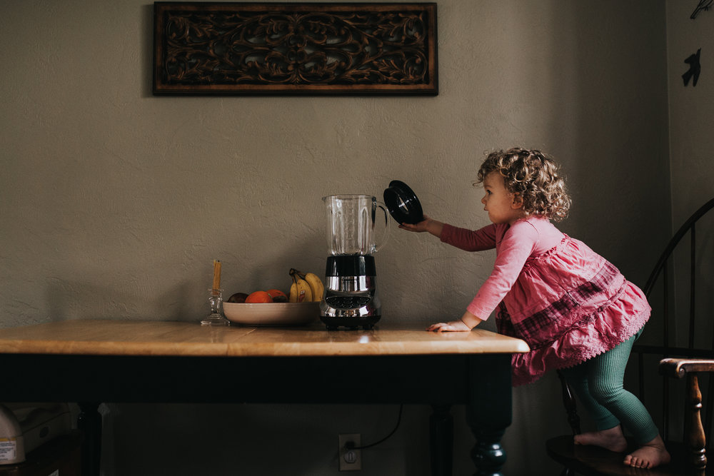 Toddler reaching for blender