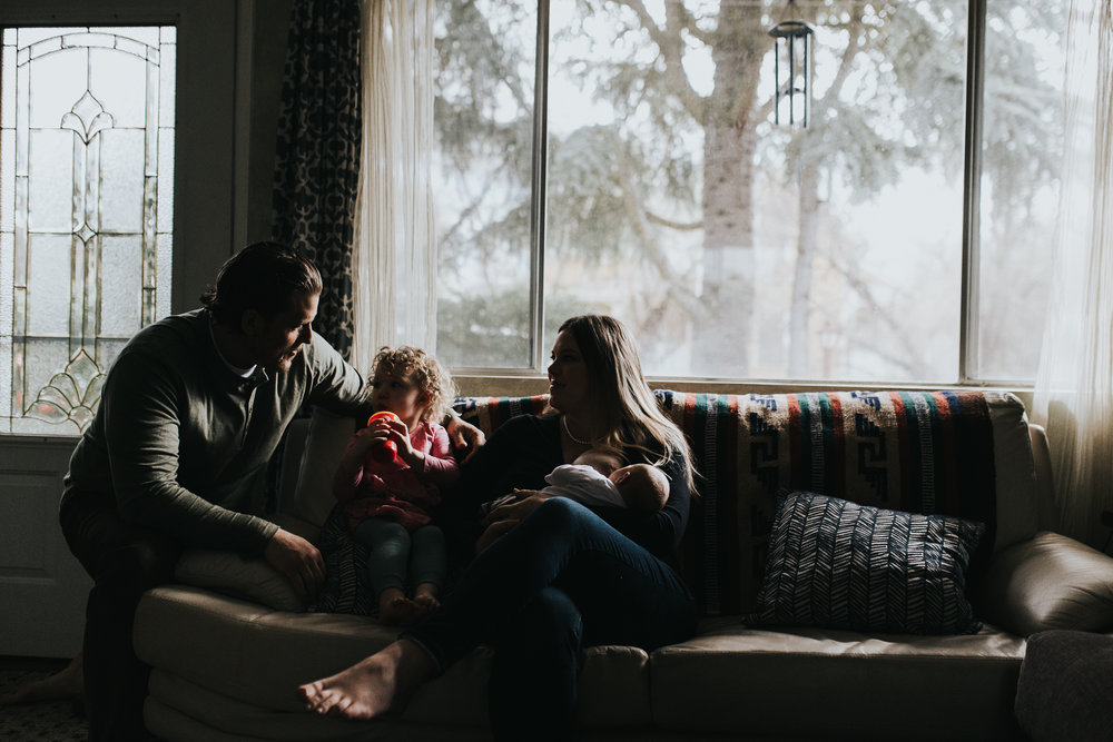 Family on couch together in beautiful light