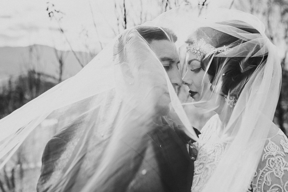 Bride and Groom under veil at Belle For Winery Ashland Oregon
