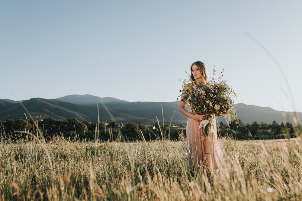 Oregon Bride holding foraged wild bouquet in Ashland Oregon