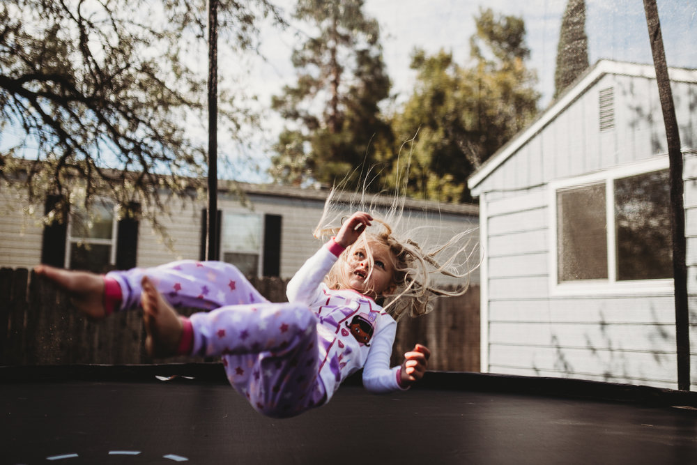 jumping toddler on trampoline southern Oregon photographer