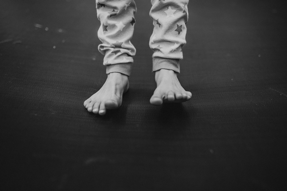 toddler feet in pajamas on trampoline southern Oregon family photographer