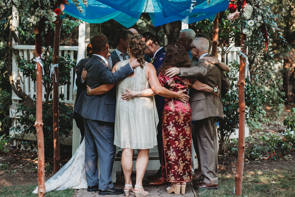 family embracing at alter southern Oregon wedding photographer