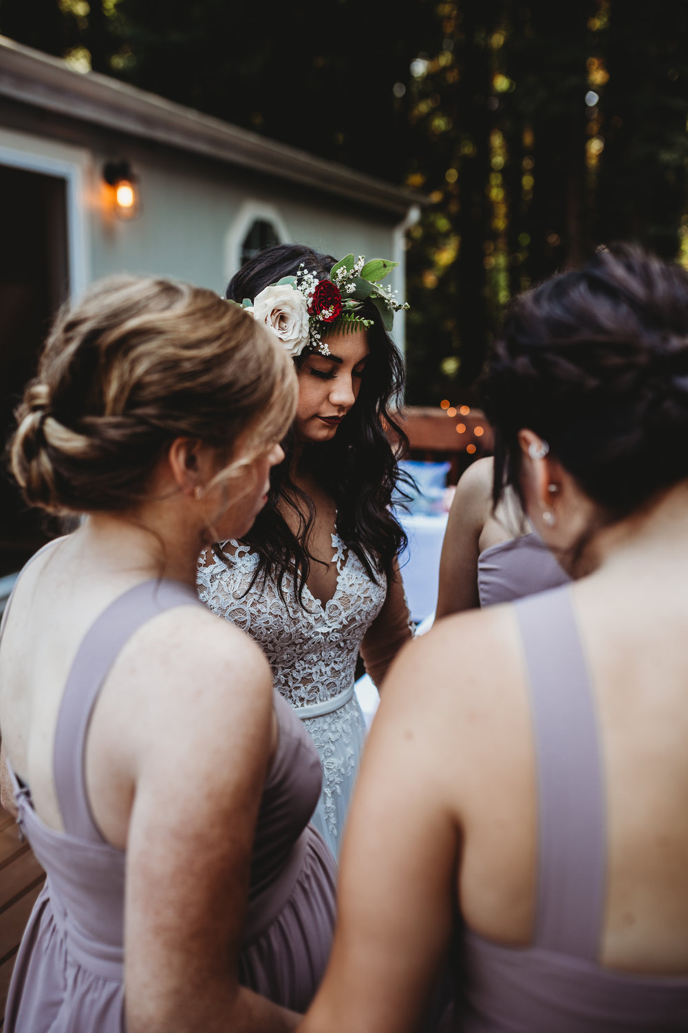 Bride and bridesmaids praying