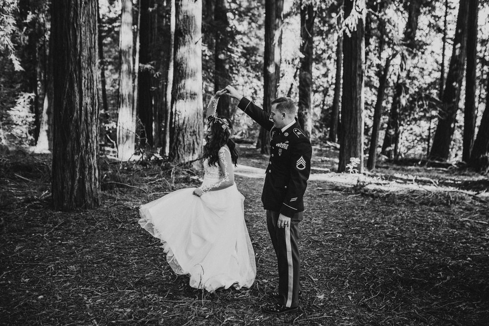 bride and groom dancing in forest