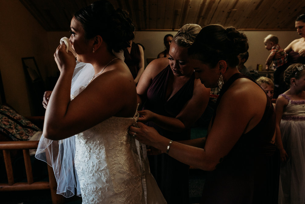 bride-getting-dressed-teary-klamath-falls-wedding-photographer
