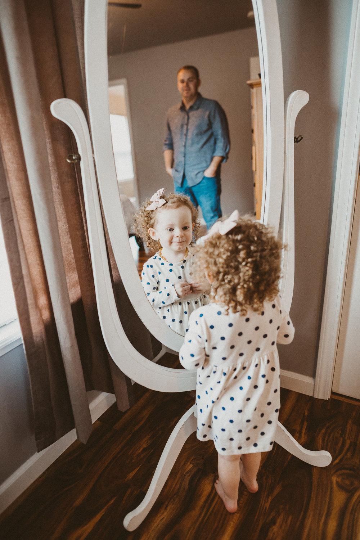 toddler girl looking mirror