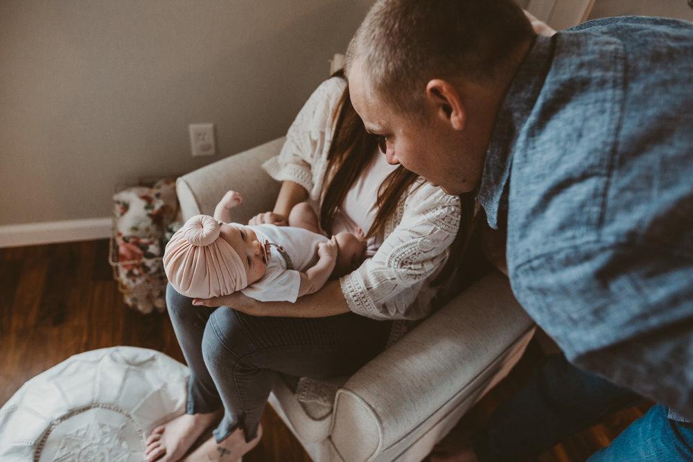 dad and newborn share gaze lifestyle photography medford