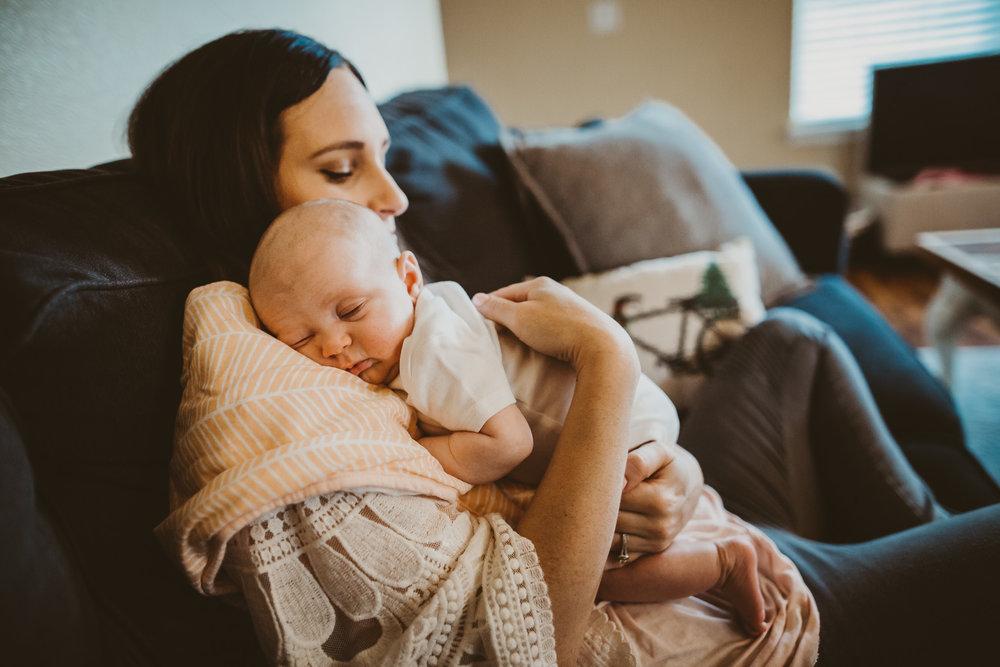 newborn sleeping on mom's shoulder