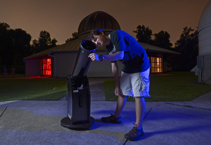 LSU Physics student Rory Bentley looks through a telescope at the Highland Road Park Observatory in Baton Rouge.