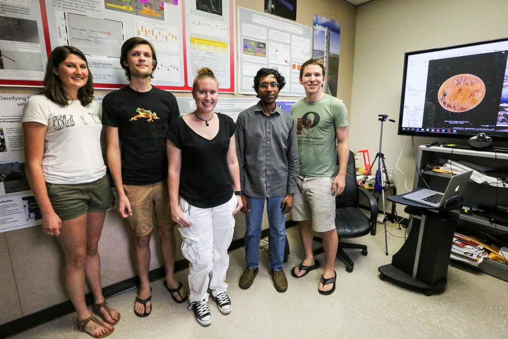 Members of Suniti Karunatillake's lab group in the Planetary Sciences Lab at LSU. From right to left: Graduate student David Susko, Suniti Karunatillake, Graduate student Nicki Button, undergraduate research intern Anthony Maue, undergraduate research intern Lorrie Carnes.
