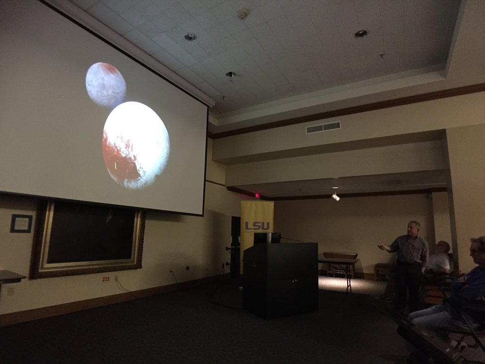 Alan Stern points out features on Pluto during a public talk at LSU. Photo credit: Paige Jarreau.