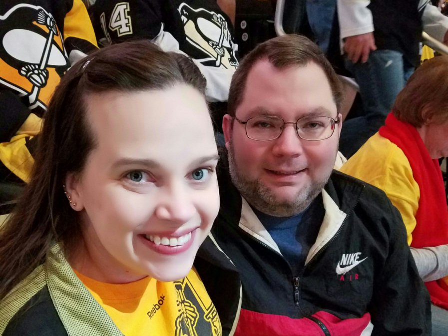 Me and my husband Derek at a Penguins playoff game in May.  Photo by Amber Stuver