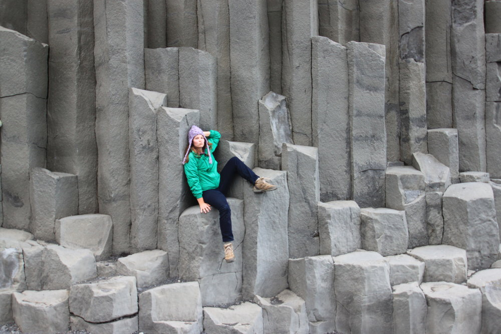Abigail Heath  strikes a pose on the hexagonal basalt columns on a beach in Southern Iceland.