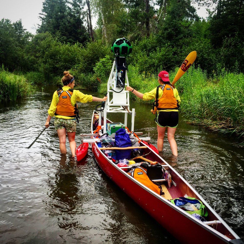 Calli and Audra, machete and paddle in hand, start the first 20 miles of the River