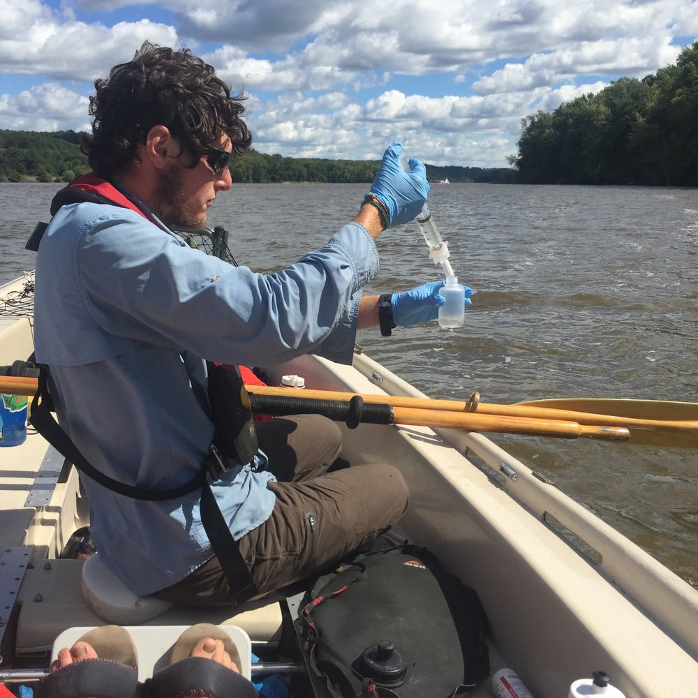 OAR Northwest paddler Eric collects samples for LSU Thrash Lab