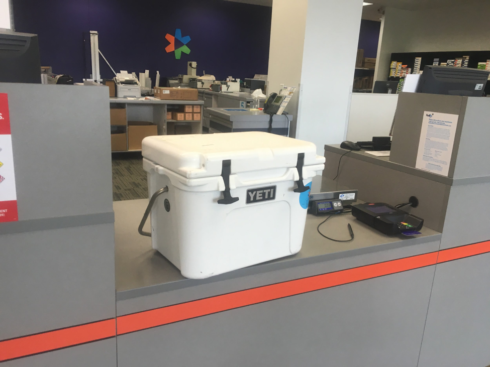A Yeti cooler of water samples waits to be shipped to LSU to be processed in the lab