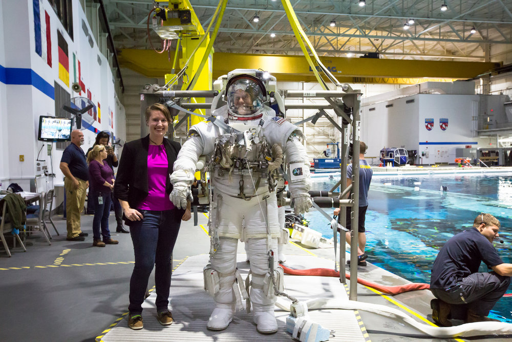 Nicki Button stands next to astronaut Thomas Marshburn before he enters the water. Photo by Paige Jarreau.