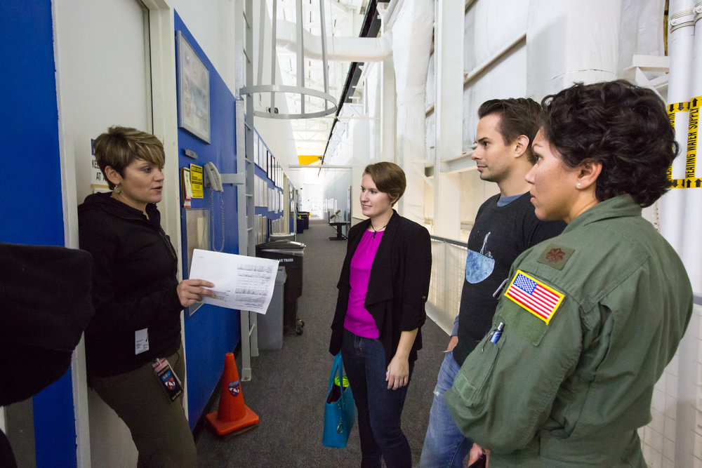 Anne McClain leads a tour at NASA NBL