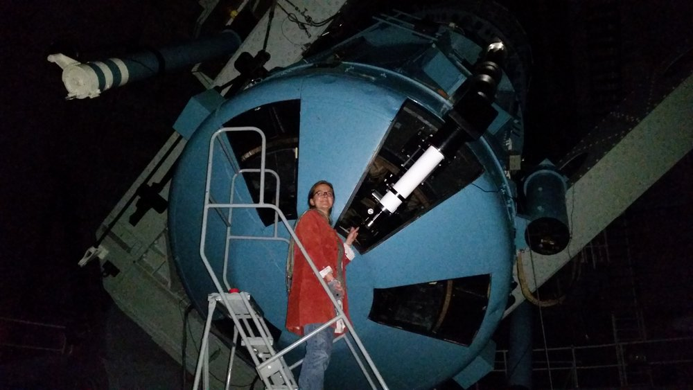 Tabby looking through the eyepiece of the 100-inch Hooker telescope at Mount Wilson Observatory.  This is the same telescope that Hubble used to discover the expanding universe.