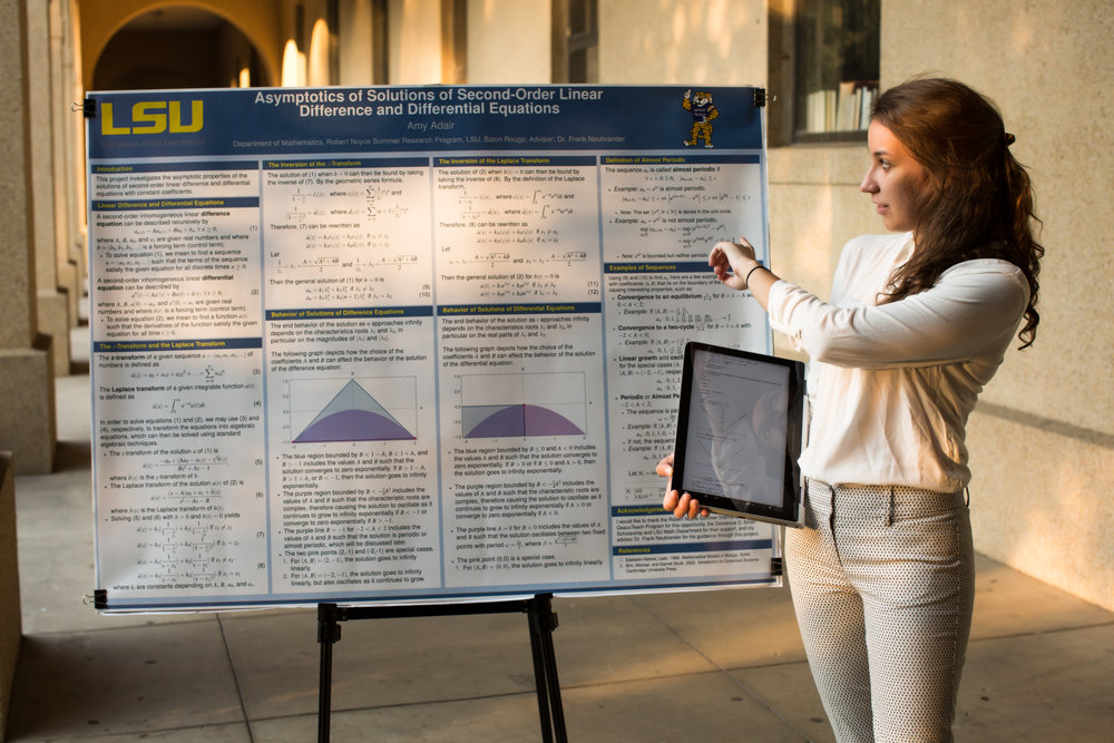 Amy Adair presents some of her own research. Photo credit: Paige Jarreau