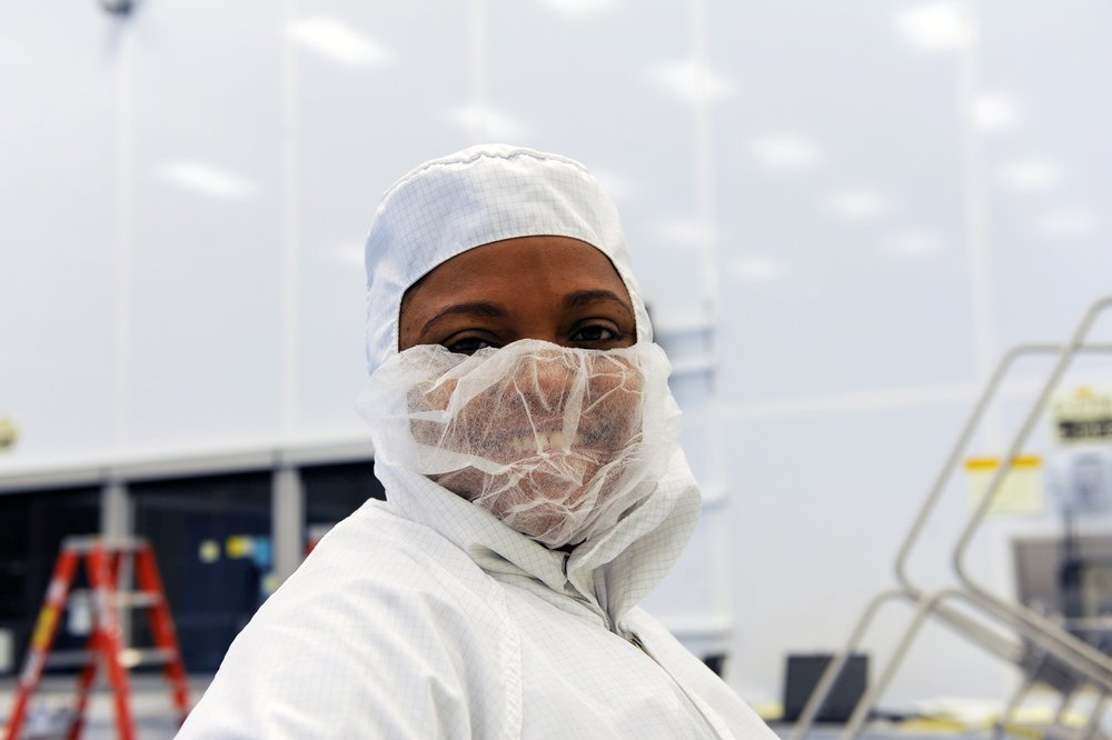Dr. Kamili Shaw in clean room dress for inspections during the NASA Magnetospheric Multiscale Mission, a project to study Earth's magnetic field. Learn more at https://mms.gsfc.nasa.gov/.