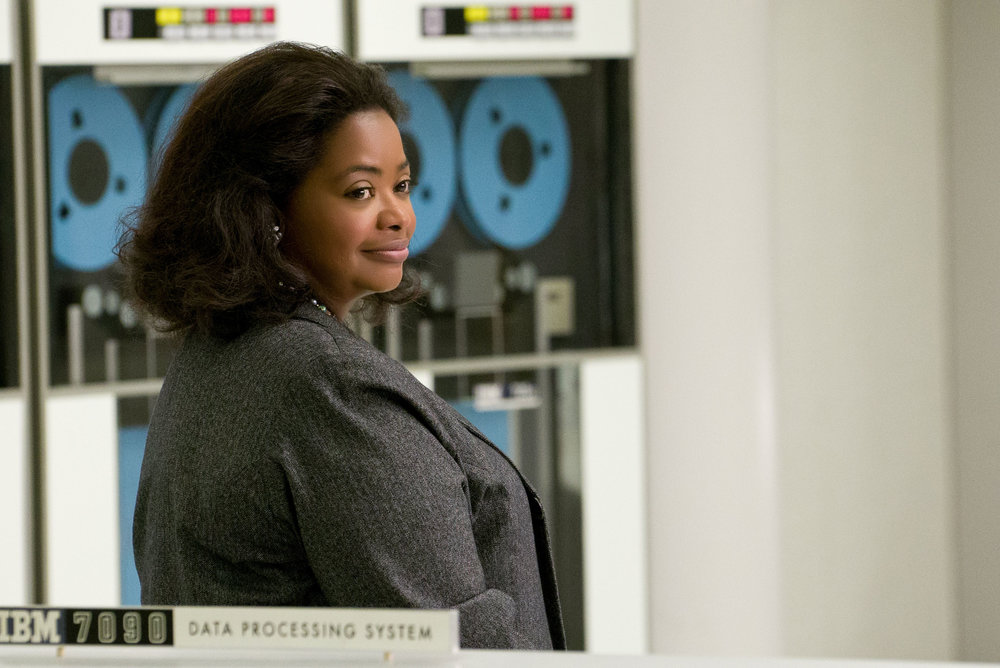 Hidden Figures film character Octavia Spencer represents Dorothy Vaughn working on the IBM data processing system. Official Hidden Figures artwork.
