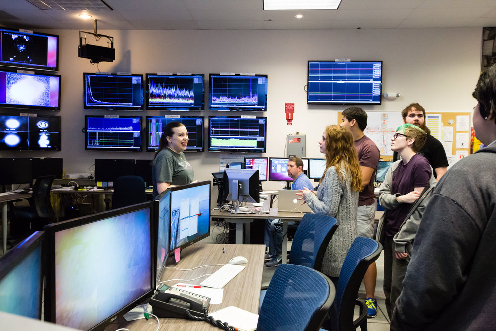 Amber in the control room at LIGO, Livingston, giving a tour to LSU students. Photo by Paige Jarreau.